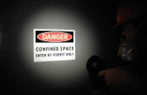 shinning light on confined space sign